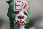 A protester pictured in Lagos, Nigeria, on Sunday.