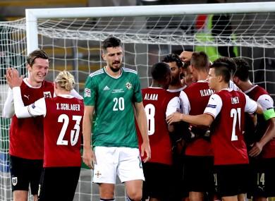 The Austrian players celebrate their winner.
