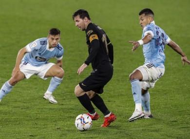 Lionel Messi under pressure against Celta Vigo.