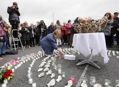 Historian Catherine Corless places a 'baby's coffin' at a temporary shrine to the babies who died in the Tuam mother and baby home. 2018.