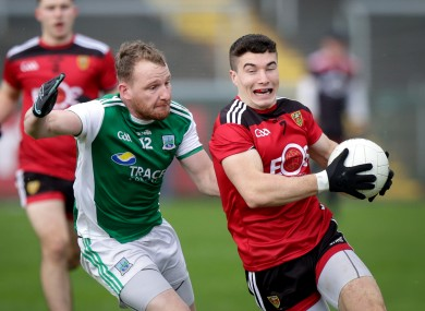 Aidan Breen challenges Down's Daniel Guinness.