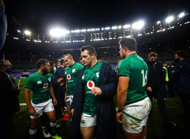 Dejected Ireland players react to France defeat.