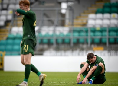 Ireland's Conor Masterson and Liam Scales dejected after the match.