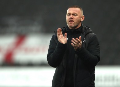 Derby County interim manager Wayne Rooney on the touchline.