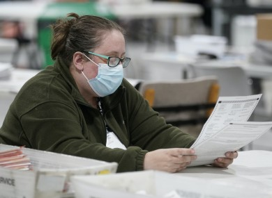 Poll worker examines ballots during the 2020 US election