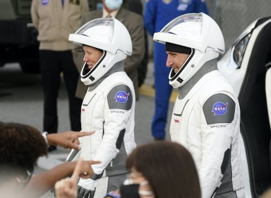 NASA astronauts Shannon Walker, left, and Michael Hopkins smile at family members as they leave for the SpaceX Crew-1 mission to the International Space Station