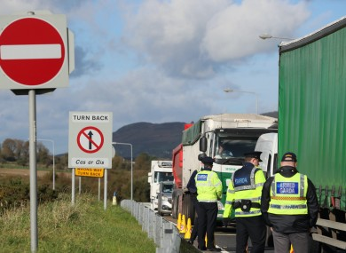 Cars and lorries queue at the border crossing between Northern Ireland and the Republic of Ireland