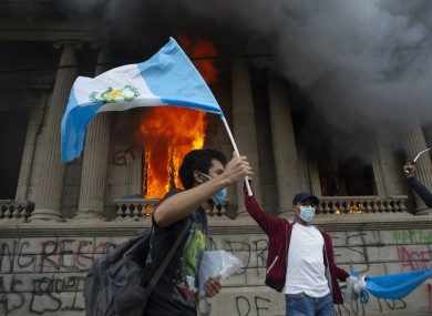 Protesters set fire to part of Guatemala's congress building