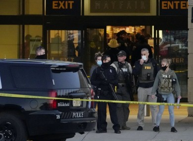 FBI officials and police stand outside the Mayfair Mall