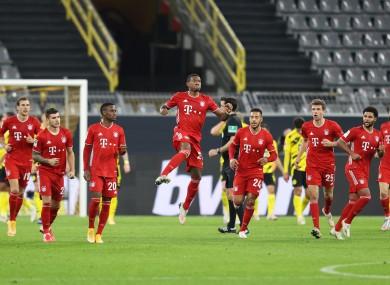 David Alaba celebrates with his Bayern team mates.