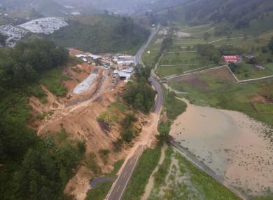 A landslide blocks a road after Storm Eta rips through northern Guatemala