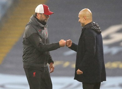 Liverpool manager Jurgen Klopp (left) and Manchester City manager Pep Guardiola after the final whistle.