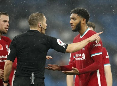 Liverpool's Joe Gomez (right) appeals to referee Craig Pawson.