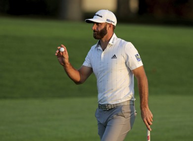 Dustin Johnson walks off the 18th today.