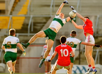 Tipperary and Cork players challenge for possession in yesterday's Munster final.