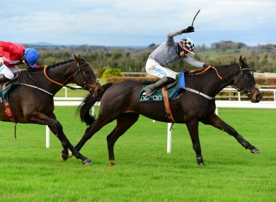 Castlegrace Paddy ridden by Bryan Cooper (right) wins the Tote Fortria Chase at Navan Racecourse.