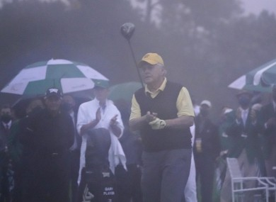 Jack Nicklaus hits the ceremonial opening drive in the Augusta rain.