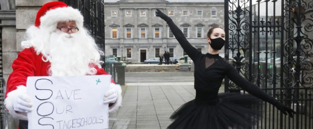 Ballet teacher Niamh O' Flannagain protesting outside the Dáil as part of a group calling on the government to reopen the performing arts sector.