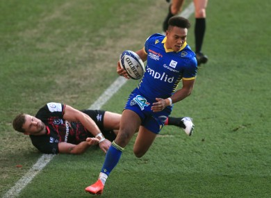 ASM Clermont Auvergne's Kotaro Matsushima (right) on the way to scoring his side's fourth try.