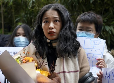 Zhou Xiaoxuan arrives at a courthouse in Beijing for her case to be heard