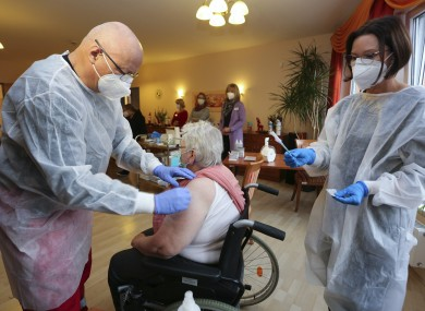 A nursing home resident is vaccinated in Halberstadt, Germany