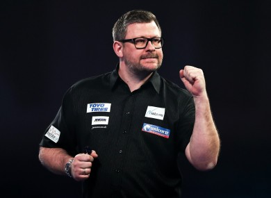 James Wade was knocked out of the PDC World Darts Championship despite recording a nine-darter.