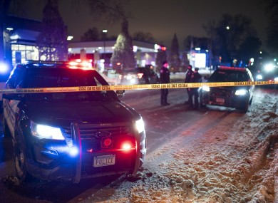 Police cars at the scene after a man was shot and killed by Minneapolis police at a petrol station