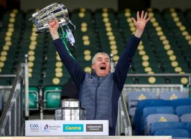 John Kiely lifting the Liam McCarthy Cup.