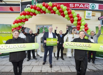 Staff and owner of the Spar in Mount Oval in Rochestown celebrate after they sold the winning ticket worth €10.7 million.
