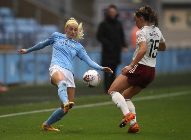 Katie McCabe closes down Chloe Kelly of Manchester City.