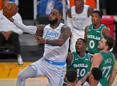 LeBron James scores in the first quarter against Dallas.