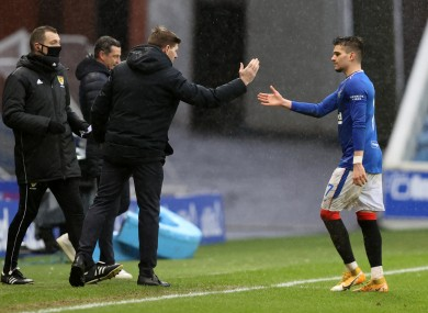 Rangers' Ianis Hagi high fives Rangers manager Steven Gerrard as he is substituted.
