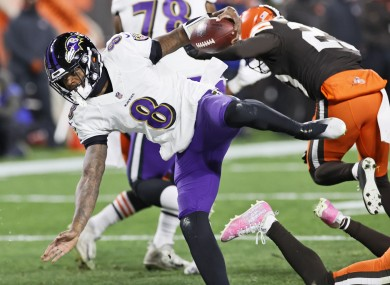 Baltimore Ravens quarterback Lamar Jackson rushes for a 5-yard touchdown during the first half of an NFL football game against the Cleveland Browns