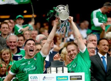 Seán Finn and Paul Browne lift the Liam MacCarthy Cup in 2018.