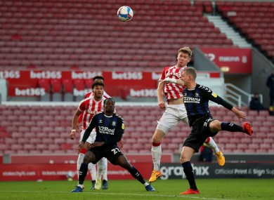 Stoke City's Nathan Collins scores.
