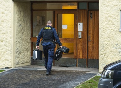 Police at the scene of the apartment in Stockholm.
