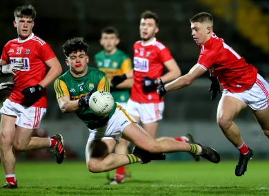 Kerry captain Oisin Maunsell in action against the Cork defence.