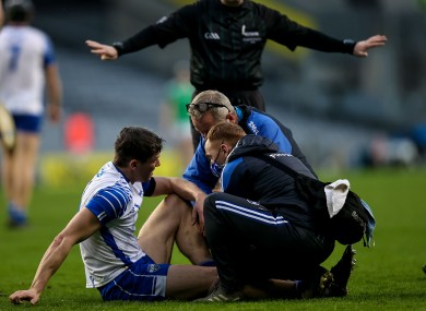 Waterford team medics with an injured Tadhg De Búrca.