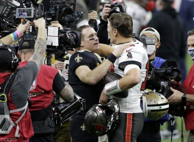 New Orleans Saints quarterback Drew Brees speaks with Tampa Bay Buccaneers QB Tom Brady.