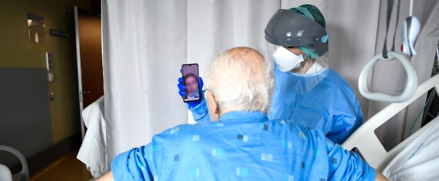 A Covid-19 patient makes a video call at a hospital in Italy (File photo)