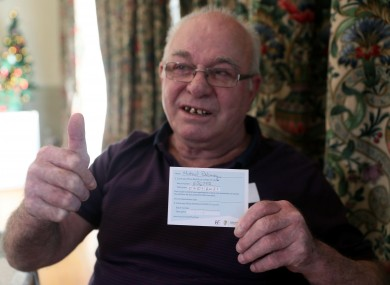Michael Delaney with his appointment card after receiving his first dose of the Pfizer/BioNTech vaccine today.