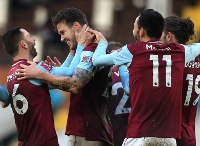 Kevin Long celebrates with his Burnley team-mates after scoring.