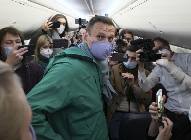 Alexei Navalny surrounded by journalists prior to his flight to Moscow yesterday.