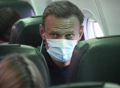 Alexei Navalny sits on the plane prior to a flight to Moscow, at the Airport Berlin Brandenburg