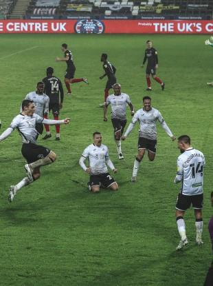 Conor Hourihane and his Swansea team-mates celebrate.