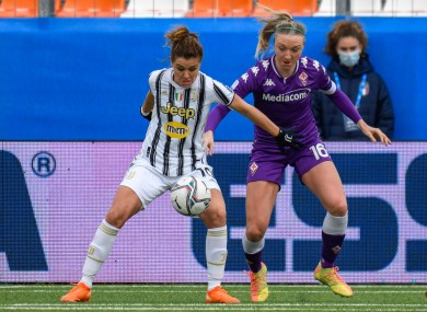 Juve's Cristiana Girelli shields the ball from Quinn.