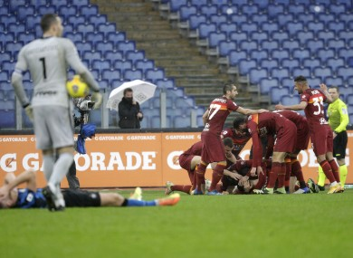 Roma's Gianluca Mancini is celebrated by teammates after his later leveller.