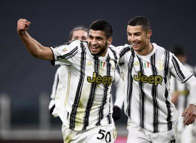 Hamza Rafia of Juventus FC celebrates with Cristiano Ronaldo.