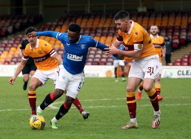 Rangers' Jermain Defoe and Motherwell's Declan Gallagher battle for possession.