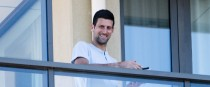Novak Djokovic pictured yesterday on the balcony at The M Suites accommodation in North Adelaide, Australia.